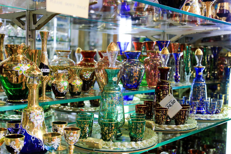 Multicolored glassware sets (glasses and jugs) in the shop window Glasses Shopping Abundance Arrangement Choice Consumerism Counter Day Display For Sale Glass Glass - Material Indoors  Large Group Of Objects Price Tag Purchase Purchases Retail  Retail  Retail Display Shopping Time Showcase Store Trade Variation