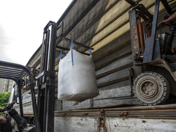 Loading big bags into the truck Big Bag Architecture Building Exterior Built Structure Close-up Day Equipment Industrial Equipment Industry Land Vehicle Loading Low Angle View Machinery Metal Mode Of Transportation Nature No People Outdoors Semitrailer Sky Technology Transportation Truck Wheel