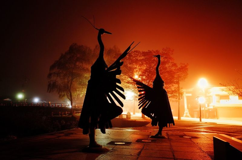 津和野 朝霧 Full Length Night Silhouette Sunset Illuminated Beautiful Real People Arts Culture And Entertainment Leisure Activity Men Outdoors Sky Flame Performing Arts Event Motion Architecture Firework Display Witch Statue Firework - Man Made Object