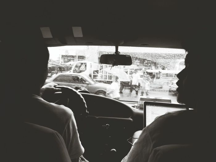 On our way to home. Rain Black And White Cars People