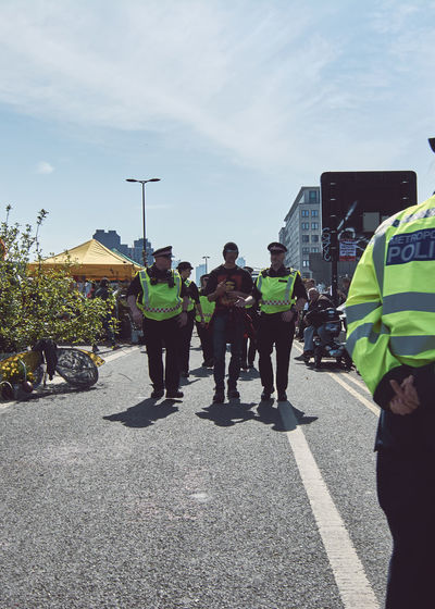 Extinction Rebellion - London 2019 Extinction Rebellion Protest Protesters London Real People Road Street Group Of People Transportation Sky Men Uniform Day Government Clothing City Crowd Large Group Of People Law Nature Sunlight Occupation Outdoors Responsibility