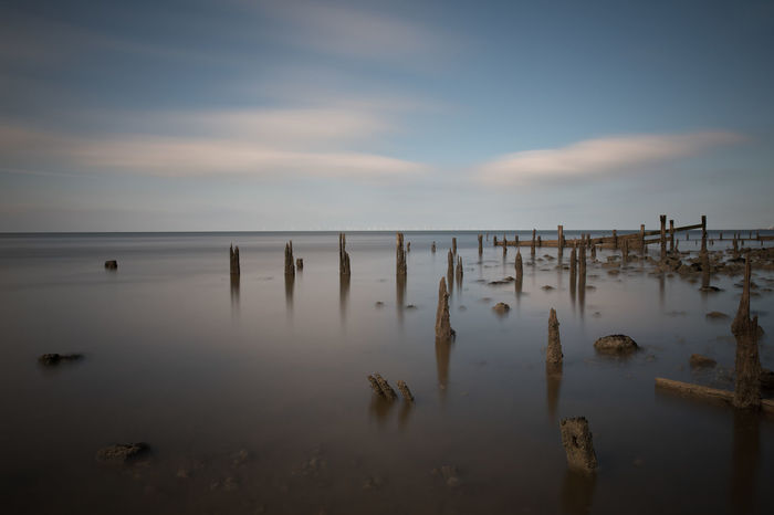 Calm Ruins Tranquility Beach Beauty In Nature Breakwater Breakwaters Cloud - Sky Horizon Horizon Over Water Idyllic Nature No People Non-urban Scene Outdoors Post Reflection Scenics - Nature Sea Seascape Sky Tranquil Scene Tranquility Wood - Material Wooden Post