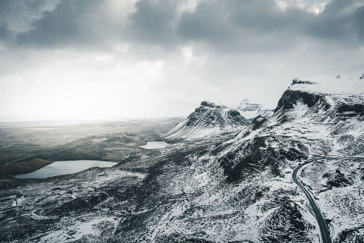 A' Chuith-Raing. Do you spot the van on the road? Location: Quiraing, Isle Of Skye, Scotland. Equipment: Fujifilm X-T2 + XF18-55 Curve Road Scotland Skye Beauty In Nature Car On The Road Cloud - Sky Cold Temperature Day Isle Of Skye Landscape Mountain Mountain Range Nature No People Outdoors Quiraing Scenics Sky Snow Street Tranquil Scene Tranquility Weather Winter Go Higher