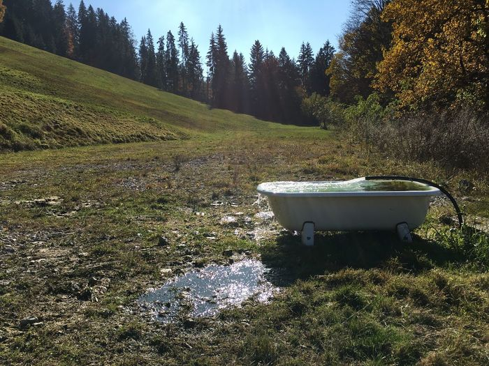 Side Shot Of Abandoned Bathtub On Landscape