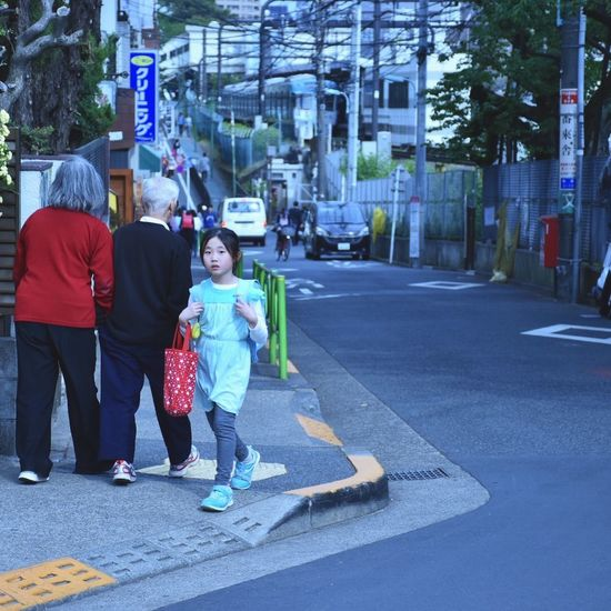Japanese school girl Architecture Boys Building Exterior Built Structure Childhood City City Life Day Full Length Girl Girls Japan Lifestyles Men Outdoors Real People Road School Street Togetherness Tourism Tree Two People Walking Women