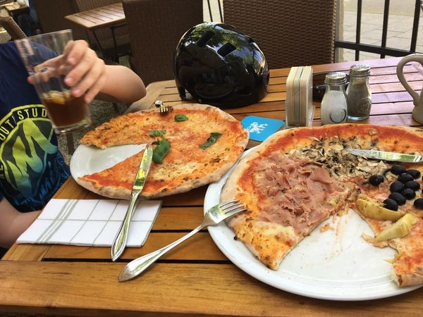 Eating Pizza, launch, Pizza, essen, Vater und Sohn, Radltour, Radtour, Pause, Helmet Biking Father And Son Father & Son Pizza Launch Eating Food Food And Drink Freshness Table Healthy Eating Wellbeing Meal Ready-to-eat Plate Eating Utensil Fork Hand