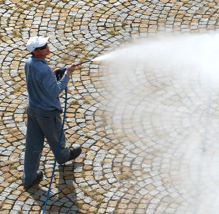 Cobble Stones Man Spraying Water Adult Day Full Length Jet Cleaning Leisure Activity Lifestyles Men One Person Outdoors People Real People Standing Technology Water Jet White Cap Ship Cleaning