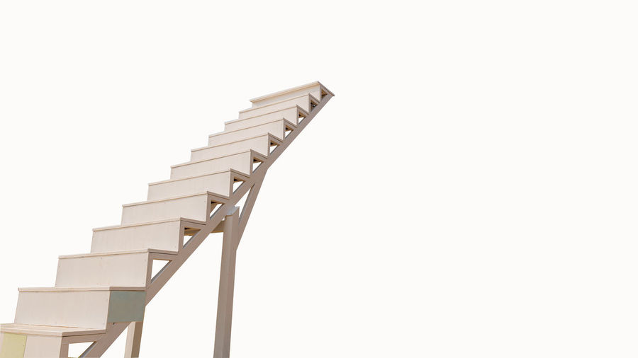 Low angle view of staircase against white background