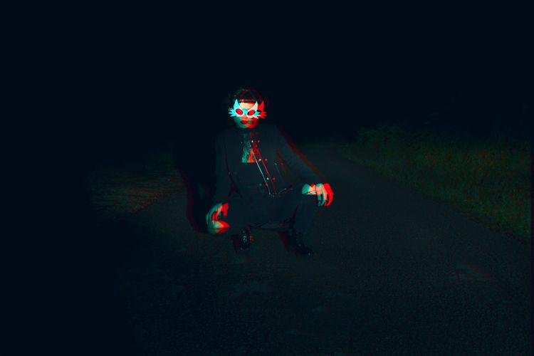 Woman wearing mask at night