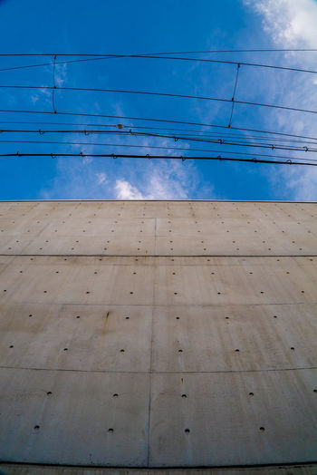 EyeEm Gallery EyeEmNewHere Architecture Blue Built Structure Cable Cloud - Sky Connection Day Electricity  Flooring Fuel And Power Generation Low Angle View Nature No People Outdoors Pattern Power Line  Power Supply Sky Street Streetphotography Telephone Line Wall Wall - Building Feature The Street Photographer - 2018 EyeEm Awards