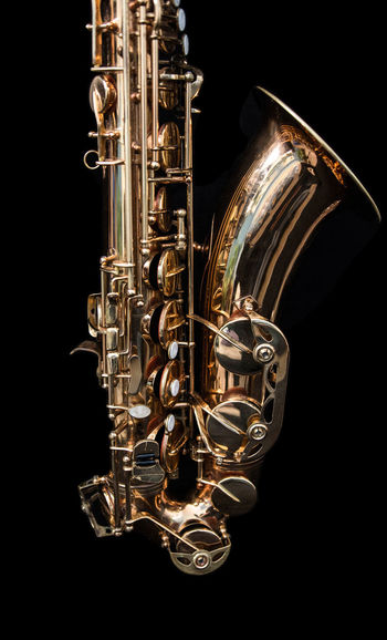 A golden saxophone. Golden Jazz Sax Arts Culture And Entertainment Black Background Brass Brass Instrument  Close-up Cut Out Gold Colored Indoors  Jazz Music Metal Music Musical Instrument No People Saxophone Single Object Studio Shot Wind Instrument