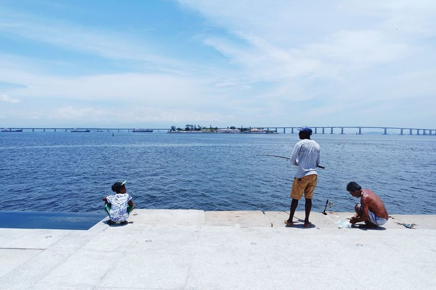 Fishing in Rio EyeEm Best Shots EyeEmNewHere Sea Beach Sky Cloud - Sky Horizon Over Water Water Outdoors Day Tranquility Men Scenics Standing Only Men Blue Togetherness People