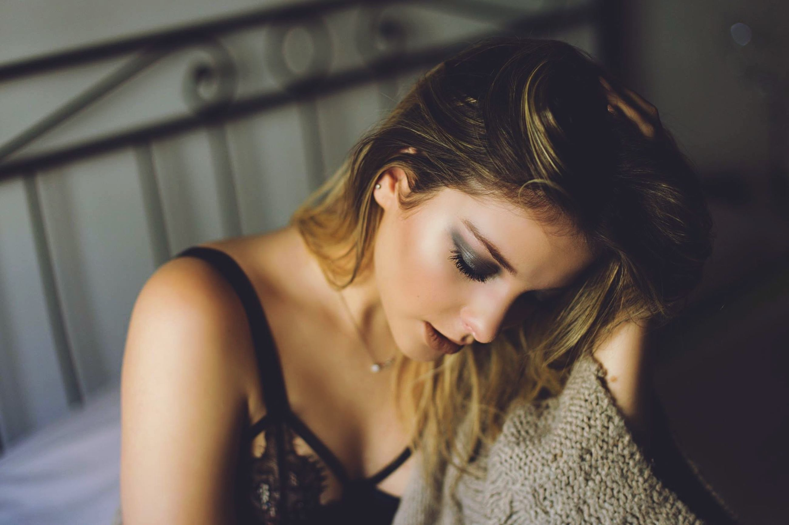 person, young women, young adult, lifestyles, headshot, long hair, indoors, portrait, focus on foreground, leisure activity, looking at camera, front view, casual clothing, close-up, contemplation, smiling