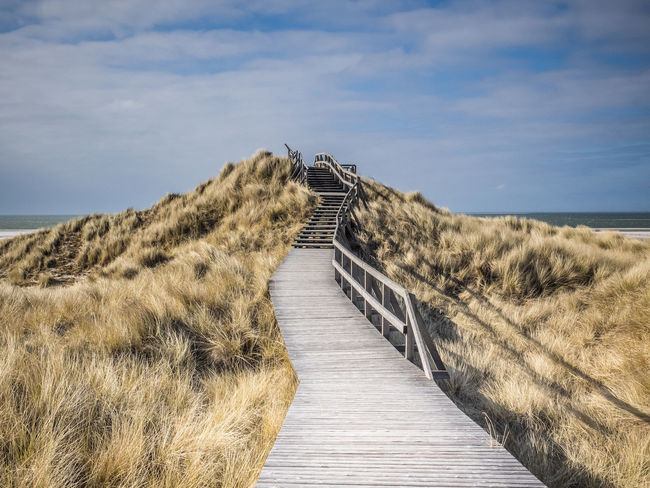 Amrum - Himmelstreppe Amrum Dünenlandschaft Himmel Himmelstreppe Meer Und Weg Stairs Beauty In Nature Clouds Clouds And Sky Day Dünen Nature No People Outdoors Sand Sand Dune Scenics Sky Stairway To Collection The Way Forward
