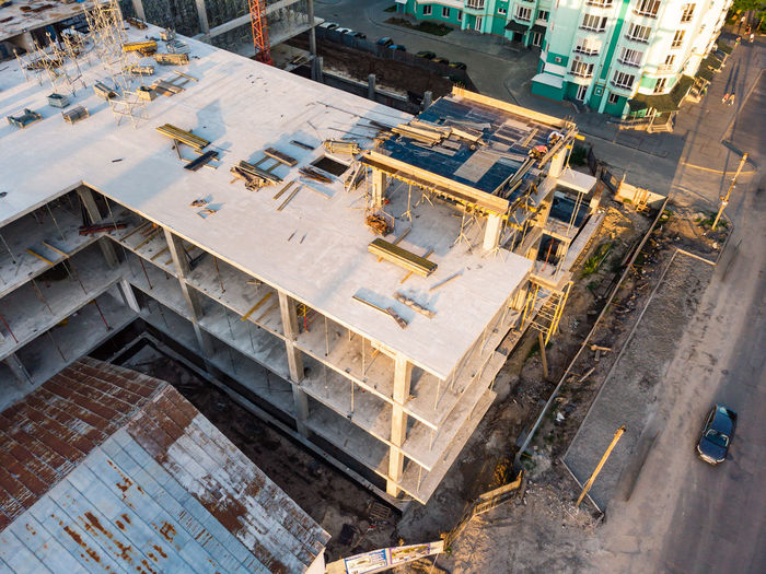 High angle view of construction site by buildings in city