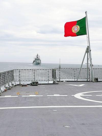 Portuguese flag on ship at sea
