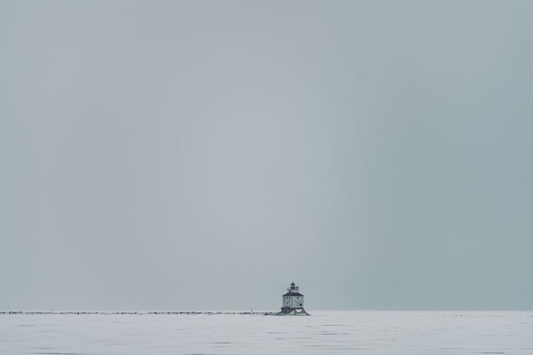 Lighthouse Centered Composition Lake Superior Lighthouse Water Sea Nautical Vessel Scenics - Nature Transportation Copy Space Beauty In Nature Sky Tranquility Tranquil Scene Nature Horizon Over Water Waterfront Travel Day