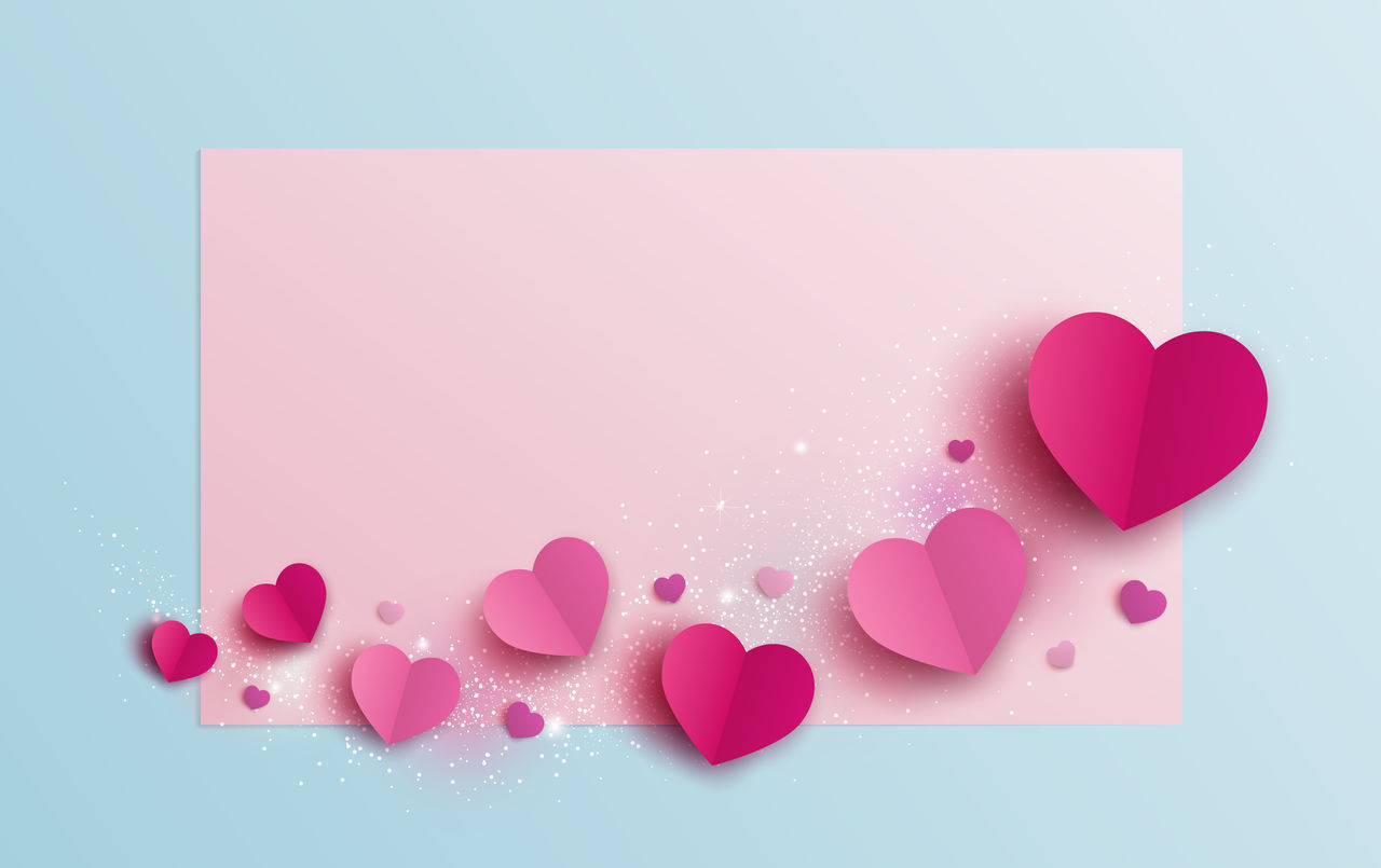HIGH ANGLE VIEW OF HEART SHAPE ON PINK PAPER