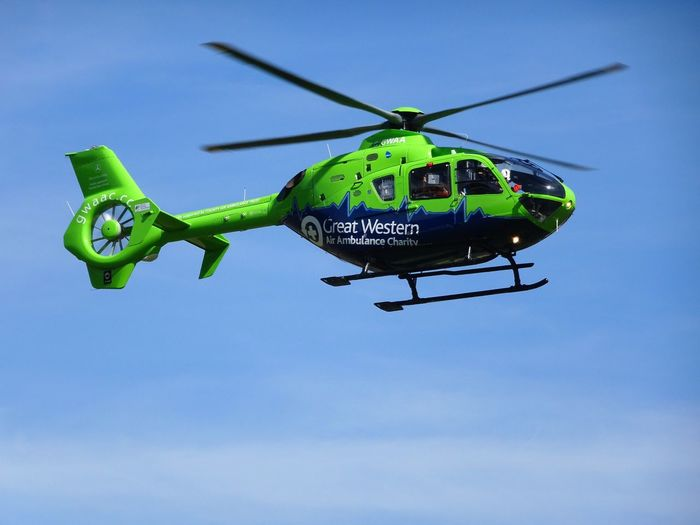 Air Ambuance Blades Blue Day Fly Green Color Helicopter Journey Mid-air Mode Of Transport Outdoors Sky