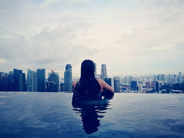 My Year My View Being able to go and see places I never imagined I can go to. This year was a happy and lucky travel year for me. a lot of firsts. Here is a view from the 57th floor infinity pool overlooking the Singapore city skyline. Urban Skyline Cityscape One Person Singapore View Infinity Pool Skyscraper