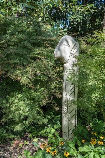 Sculpture of statue in garden