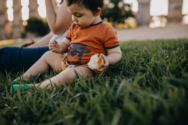 Cute boy on grass