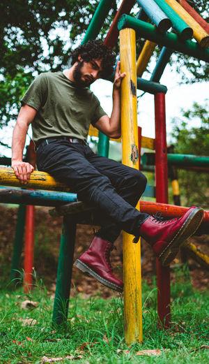 Man sitting on seat in playground