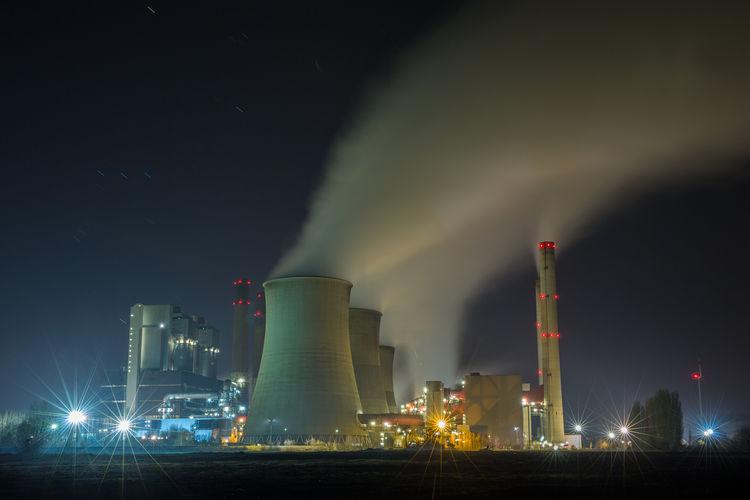 Smoke emitting from factory at night