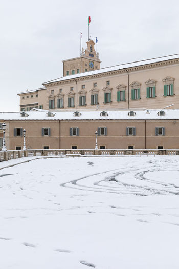 Rome, Italy - February 26, 2018: An exceptional weather event causes a cold and cold air across Europe, including Italy. Snow comes in the capital, covering streets and monuments of a white white coat. In the photo, Piazza del Quirinale, home of the President of the Republic. Place Snow ❄ Architecture Building Building Exterior Built Structure Cold Temperature Colle Day Facade Building Flag Italian Flag Nature No People Outdoors Patriotism Republic Simbol Of City Sky Snow Snowing Weather White Winter