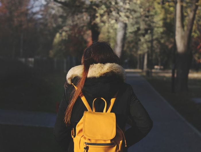 Girl walking at a park with a yellow backpack autumn scenery One Woman Only One Person Adult Outdoors Day Adults Only Only Women People Tree Nature Close-up Park Concept Fineart Autumn Autumn Colors Forest ınstagram