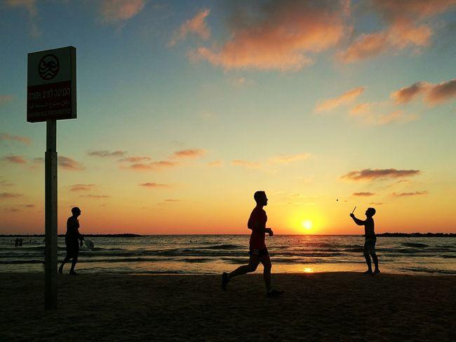 The Color Of Sport Sunset Water Sea Sun Beach Silhouette Men Scenics Nature Beauty In Nature Sky Colors Orange