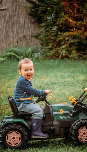Happy boy sitting on grass