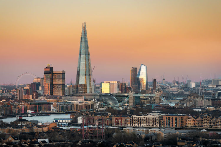 The iconic skyline of London, UK, during a golden sunrise Building Exterior Architecture Built Structure City Sky Office Building Exterior Cityscape Building Tall - High Sunset Skyscraper Travel Destinations Landscape Modern Outdoors Urban Skyline Sunrise London Dawn Morning United Kingdom Tower Bridge  Shard Golden Hour