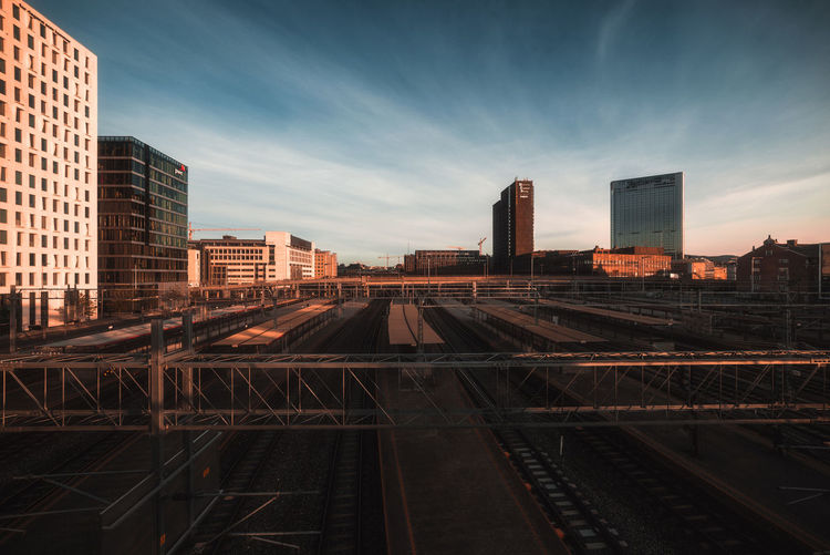 The Architect - 2018 EyeEm Awards Architecture Building Building Exterior Built Structure City Cityscape Cloud - Sky Day Landscape Nature No People Office Building Exterior Outdoors Rail Transportation Railroad Track Sky Skyscraper Sunset Tall - High Track Urban Skyline The Great Outdoors - 2018 EyeEm Awards