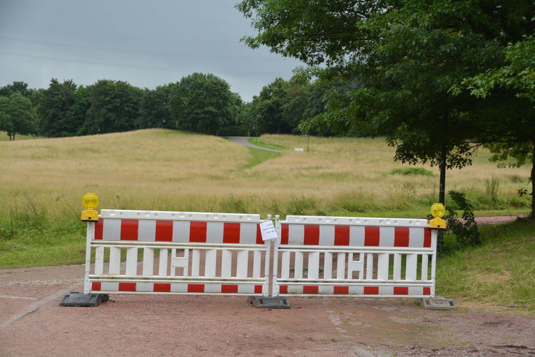 Barricade against grassy field