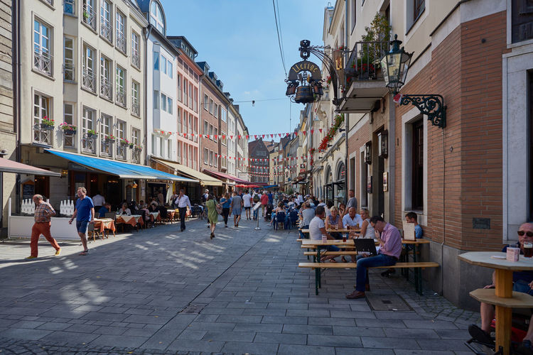 DUESSELDORF, GERMANY - AUGUST 17, 2016: Visitors and tourists populate the Altsadt near famous Uerige brewery pub Altstadt Atmosphere Bar Blu Sky City Life City Street Daytime Düsseldof High Resolution Lifestyles NRW Outdoors People R Relaxing Restaurant Rheinland-Pfalz  Rhine Promna S Shopping Tourism Travel Destinaton