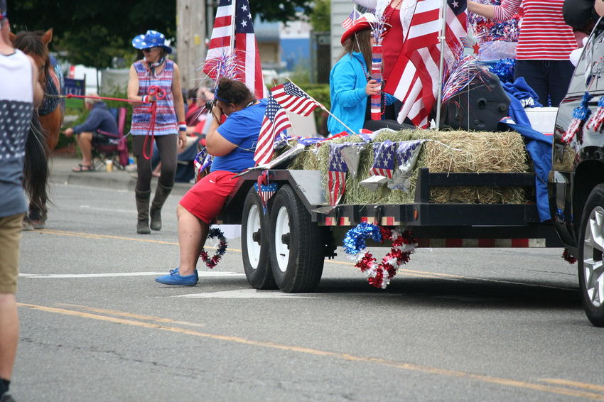 4th Of July 2016 4th Of July Parade American Flag Casual Clothing Celebration City City Life City Street Day Leisure Activity Lifestyles Medium Group Of People Multi Colored Outdoors Patriotism Red White And Blue Road Street Live For The Story