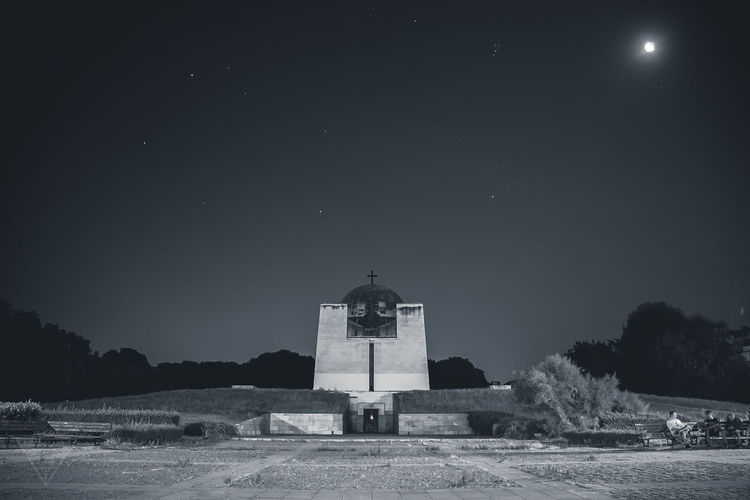Church against clear sky at night