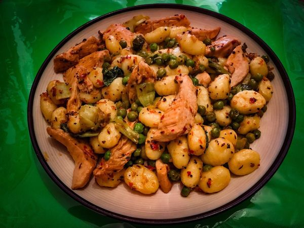 Italian gnocchi with chilly chicken and garden peas Ready-to-eat Food Food And Drink Serving Size Freshness High Angle View Indoors  Unhealthy Eating Plate No People Close-up Fast Food Cooking Chef Cheflife Italian Italian Food