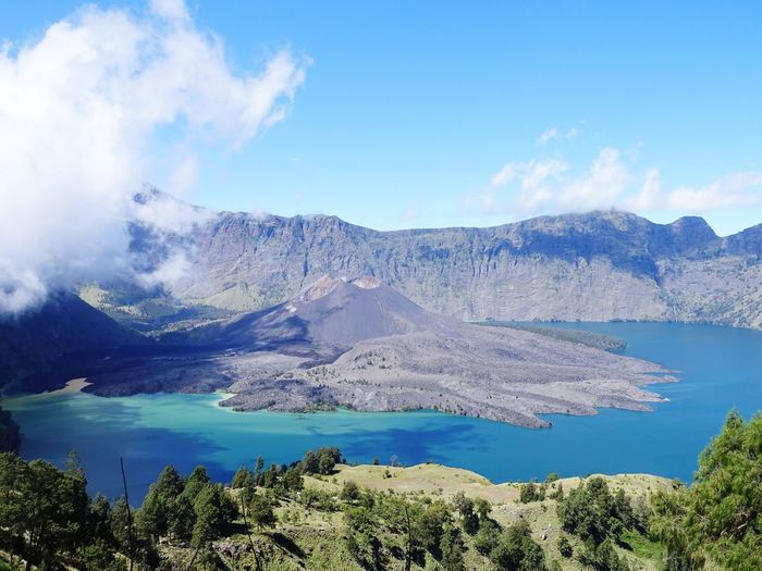 Rinjani Mountain Water Tree Mountain Blue Lake Pinaceae Forest Pine Tree Volcanic Landscape Snow Volcanic Activity Active Volcano Natural Landmark Rocky Mountains Lava