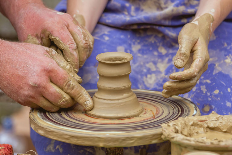 Close-Up Of People Making Pottery
