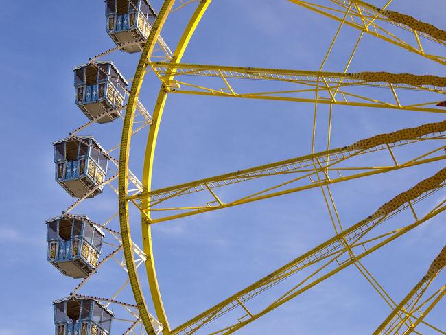Amusement Park Amusement Park Ride Architecture Arts Culture And Entertainment Blue Built Structure Clear Sky Day Fairground Ferris Wheel Fun Leisure Activity Low Angle View Metal Nature No People Outdoors Pattern Sky Yellow