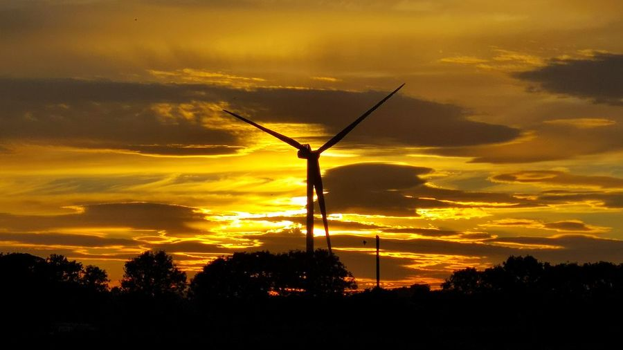 Sunset Cloud - Sky Yorkshire Fraisthorpe Trees Tree Wind Power Sunset Wind Turbine Technology Silhouette Yellow Business Finance And Industry Orange Color Sky Windmill Environmental Conservation Renewable Energy Dramatic Sky Alternative Energy Sustainable Resources