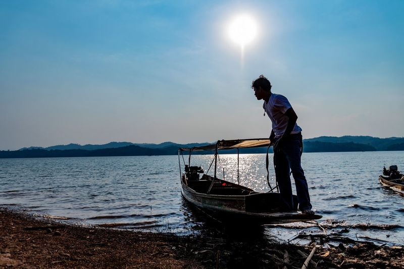My weekend at Sangkhlaburi, Thailand EyeEm Thailand Nature Photography Travel Thailand Water Transportation Nautical Vessel Sky Mode Of Transportation One Person My Best Photo Men Beauty In Nature Standing Outdoors Fisherman