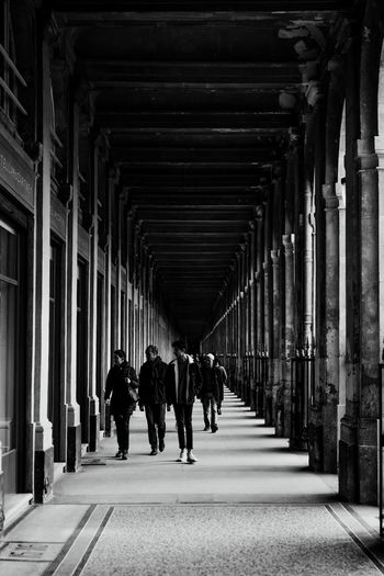 Architecture Direction Built Structure The Way Forward Men Group Of People The Art Of Street Photography Walking Real People In A Row Indoors  Rear View Lifestyles People Architectural Column Arcade Diminishing Perspective Adult Building The Art Of Street Photography
