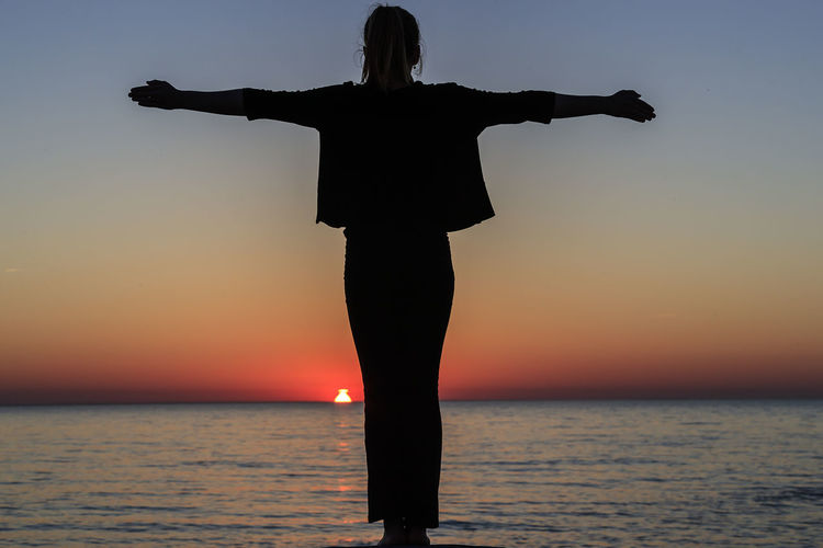 Embracing life Baltic Sea Sweden Arms Outstretched Arms Raised Beauty In Nature Horizon Horizon Over Water Human Arm Leisure Activity Lifestyles Limb Nature One Person Outdoors Real People Rear View Scenics - Nature Sea Silhouette Sky Standing Summer Sunset Water Öland