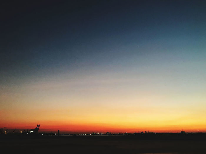 Scenic view of silhouette landscape against clear sky during sunset