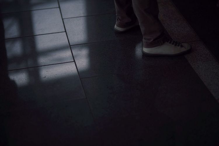 A men stand in the dark. Photography Portrait Shoes Cool