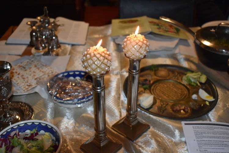 Seder Passah Pesach Table Passah Jewish Passover Feast Judaism Table Food Food And Drink Indoors  Burning Candle Fire Flame No People Still Life Dessert Freshness High Angle View Sweet Food Sweet Close-up Fire - Natural Phenomenon Business Heat - Temperature Cake Temptation Easter Seder
