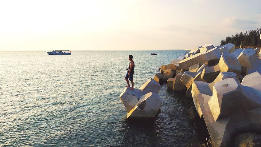 Sea Water Real People Nautical Vessel Outdoors Lifestyles Full Length Men Clear Sky Leisure Activity One Person Horizon Over Water Sky Nature Beauty In Nature Occupation Day Scenics